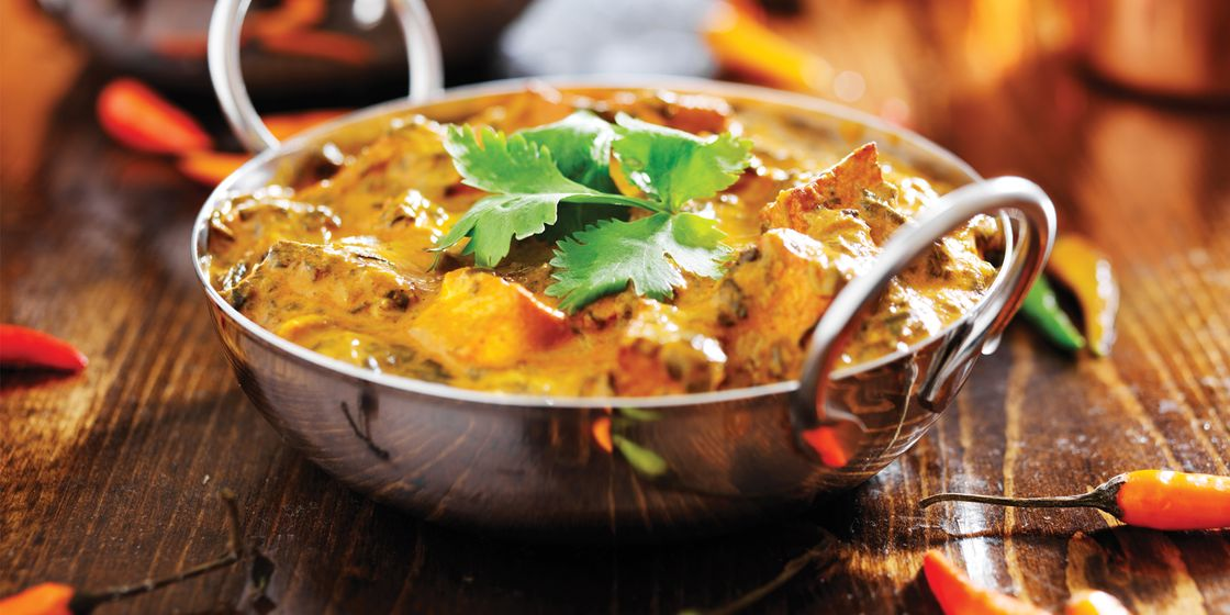 Senior finance team hold curry evening